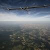20120724_crossingsfrontiers_returntopayerne_puydedome_BP_revillard L'avion solar impulse en route pour payerne survole le puy de dome et la ville de clermont ferrand