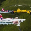 Nigel Lamb and Paul Bohomme of Great Britain give Peter Besenyei of Hungary an aerial view of their home country ahead of the weekend's Red Bull Air Race World Championship stop in Ascot over the Uffington White Hores in the Oxfordshire countryside near Oxford in the United Kingdom on August 11, 2015.