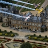 Nigel Lamb and Paul Bohomme of Great Britain give Peter Besenyei of Hungary an aerial view of their home country ahead of the weekend's Red Bull Air Race World Championship stop in Ascot over the Waddesdon Manor in the heart of the Buckinghamshire countryside near Oxford in the United Kingdom on August 11, 2015.