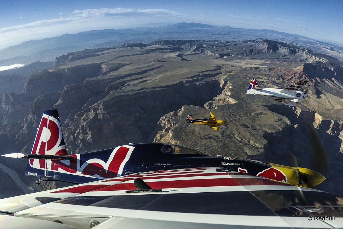 Paul Bonhomme of Great Britain, Peter Besenyei of Hungary and Matt Hall of Australia fly over the Grand Canyon prior to the eight and final stage of the Red Bull Air Race World Championship in Arizona, United States on October 14, 2015.