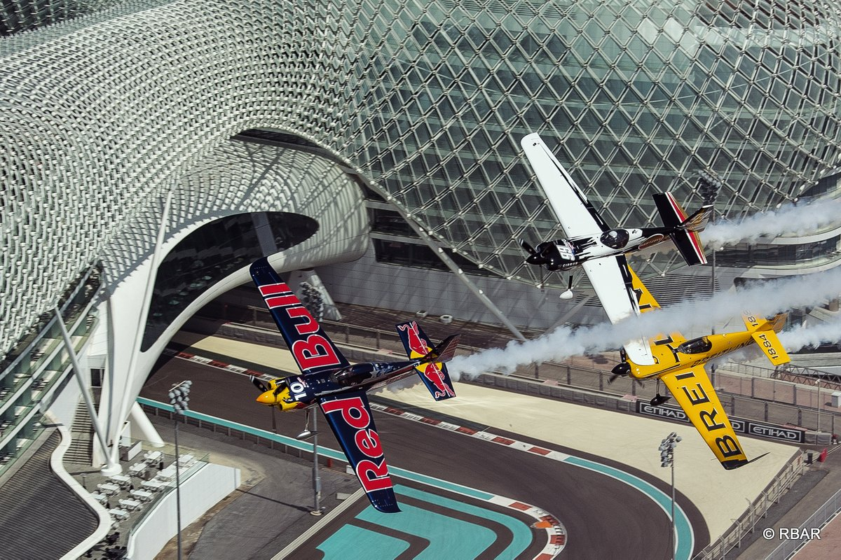 Kirby Chambliss and Michael Goulian and Nigel Lamb Yoshihide Muroya  fly in formation over the Yas Marina Circuit prior to the first stop of the Red Bull Air Race World Championship in Abu Dhabi, United Arab Emirates on February 26, 2014.