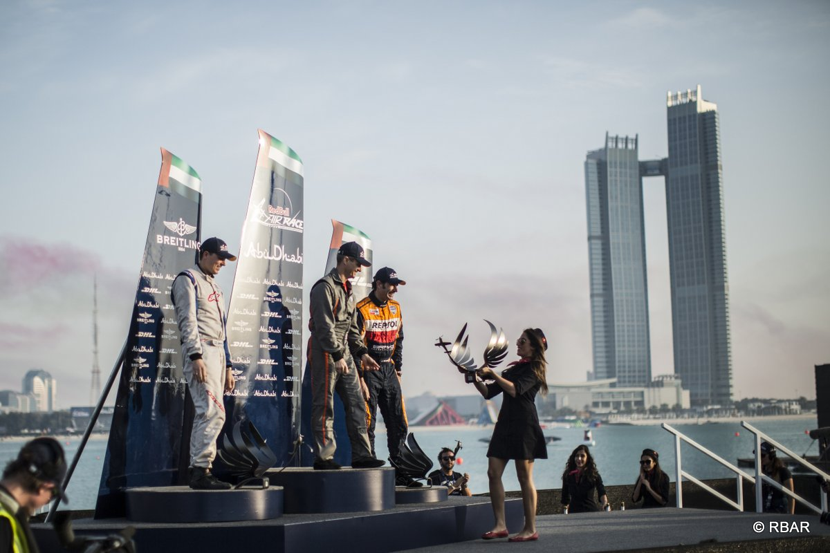Daniel Ryfa of Sweden (L), Francois Le Vot of France (C) and Juan Velarde of Spain (R) celebrate during the Challengers Cup award ceremony for the first stage of the Red Bull Air Race World Championship in Abu Dhabi, United Arab Emirates on February 28, 2014.