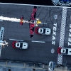 Kirby Chambliss of the United States flies in formation with Hannes Arch of Austria prior to the sixt stage of the Red Bull Air Race World Championship over the Texas Motor Speedway in Fort Worth, United States on September 04, 2014.