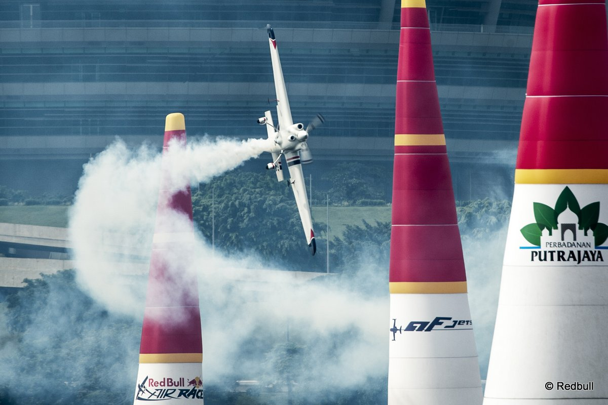 Matthias Dolderer of Germany performs during the training for the third stage of the Red Bull Air Race World Championship in Putrajaya, Malaysia on May 16, 2014.