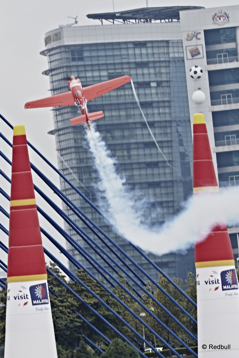 Pete McLeod of Canada performs during the qualifying for the third stage of the Red Bull Air Race World Championship in Putrajaya, Malaysia on May 17, 2014.