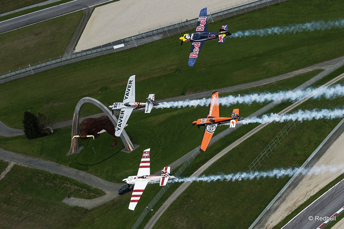 Hannes Arch of Austria flies in formation with Paul Bonhomme of Great Britain, Peter Besenyei of Hungary and Nicolas Ivanoff of France during a Recon flight prior to the eight stage of the Red Bull Air Race World Championship over the Red Bull Ring in Spielberg, Austria on October 22, 2014.