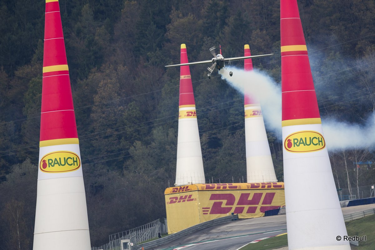 Yoshihide Muroya of Japan flies during the training for the eighth stage of the Red Bull Air Race World Championship at the Red Bull Ring in Spielberg, Austria on October 24, 2014.