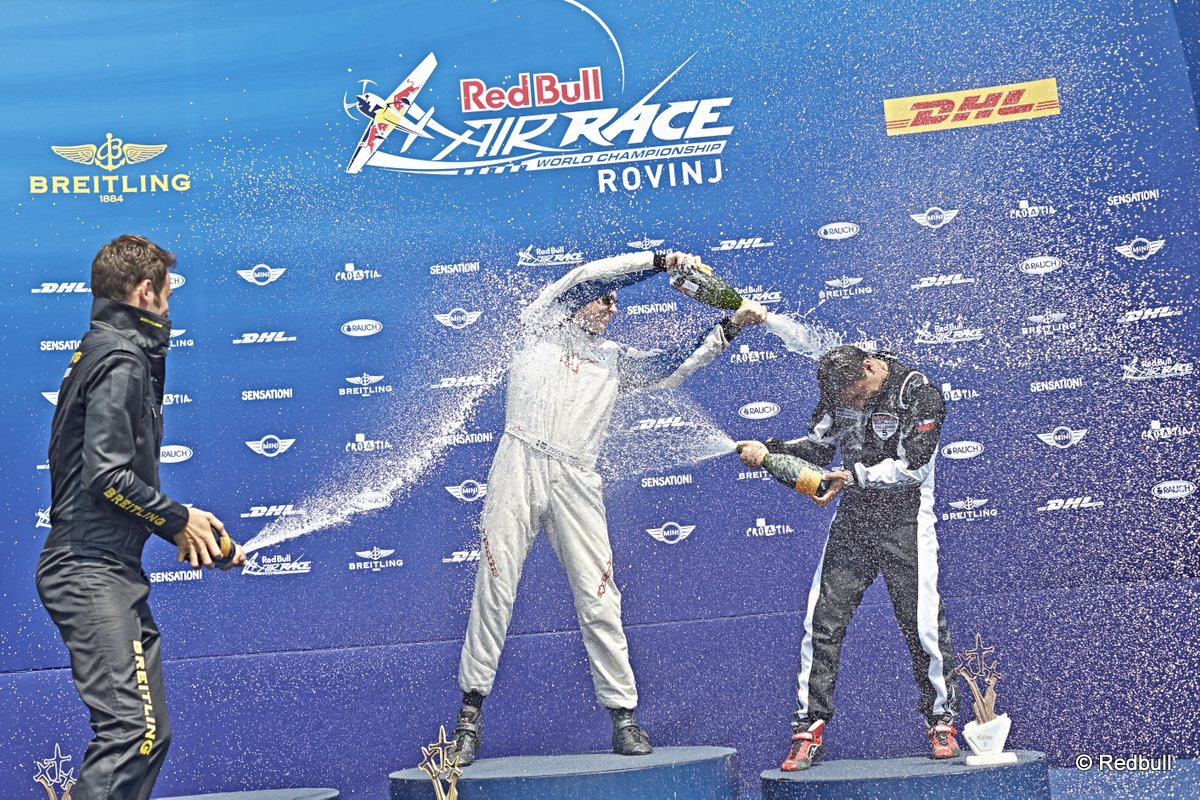 Mikael Brageot of France (L), Daniel Ryfa of Sweden (C) and Cristian Bolton of Chile (R) celebrate during the Challenger Cup Award Ceremony of the third stage of the Red Bull Air Race World Championship in Rovinj, Croatia on May 31, 2015.