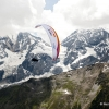 Competitor flies at the Red Bull X-Alps 2013 at Ortler in Sulden, Italy on July 10th, 2013