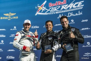 Matt Hall of Australia (L), Paul Bonhomme of Great Britain (C) and Pete McLeod of Canada (R) celebrateduring the Flower Ceremony of the first stage of the Red Bull Air Race World Championship in Abu Dhabi, United Arab Emirates on February 14, 2015. // Balasz Gardi/Red Bull Content Pool // P-20150214-00180 // Usage for editorial use only // Please go to www.redbullcontentpool.com for further information. //