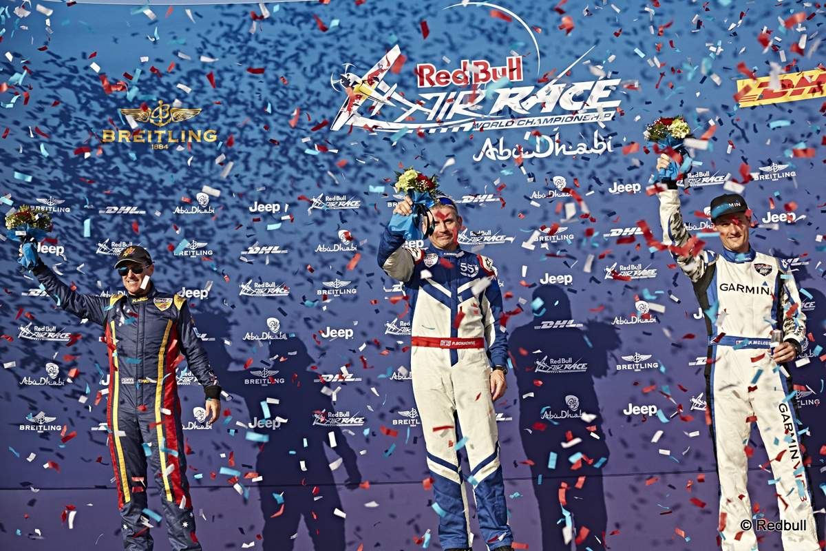 Matt Hall of Australia (L), Paul Bonhomme of Great Britain (C) and Pete McLeod of Canada (R) celebrateduring the Flower Ceremony of the first stage of the Red Bull Air Race World Championship in Abu Dhabi, United Arab Emirates on February 14, 2015. // Balasz Gardi/Red Bull Content Pool