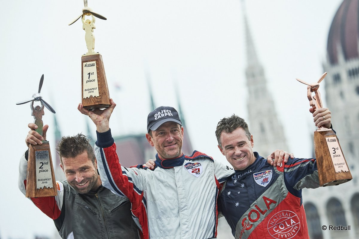Matthias Dolderer of Germany (C) celebrates with Hannes Arch of Austria (L) and Matt Hall of Australia (R) during the Award Ceremony at the fourth stage of the Red Bull Air Race World Championship in Budapest, Hungary on July 17, 2016. // Armin Walcher / Red Bull Content Pool // P-20160717-00737 // Usage for editorial use only // Please go to www.redbullcontentpool.com for further information. //